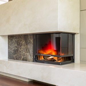 Shot of a concrete fireplace in a modern living room
